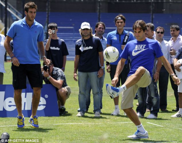 Control: Roger Federer (right) and Juan Martin Del Potro (left) took part in a game of football-tennis just hours before their second exhibition match in the Argentinan city of Tigre