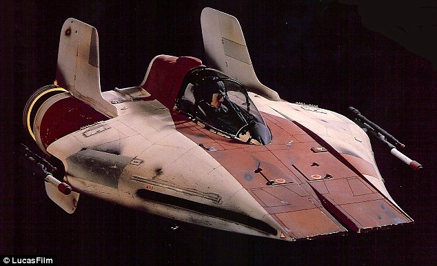 An A-Fighter (this time, piloted by a man), flies through space on its way to the Death Star