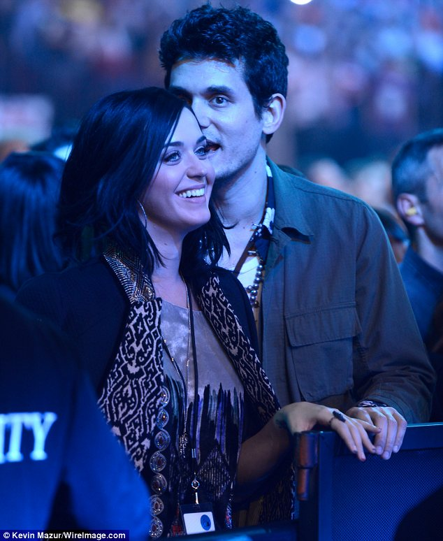Two days earlier: Katy looked blissfully in love with her 35-year-old boyfriend as they swayed to the music of the Rolling Stones together