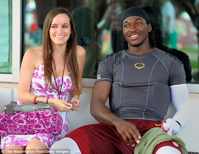 Rebecca Liddicoat, (left), sits with her fiance, Washington Redskins' rookie quarterback Robert Griffin III after the 4th day of training camp at Redskins Park in Ashburn VA  July 30 2012