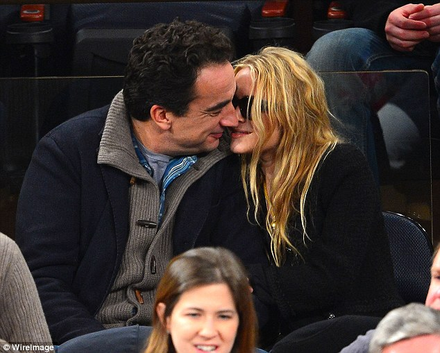 Competition: Olivier Sarkozy and Mary-Kate Olsen also put on a display of affection as they attend the Los Angeles Lakers vs New York Knicks game
