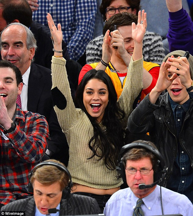 Delighted: Vanessa looked really happy at one point during the game and lifted her hands up to cheer revealing a little bit of her tummy