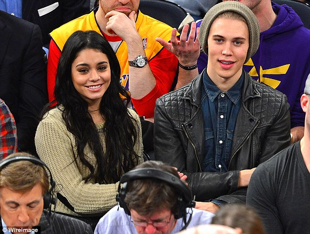 Happy couple: Vanessa and Austin are regularly at basketball games, where they often spend more time kissing than watching it