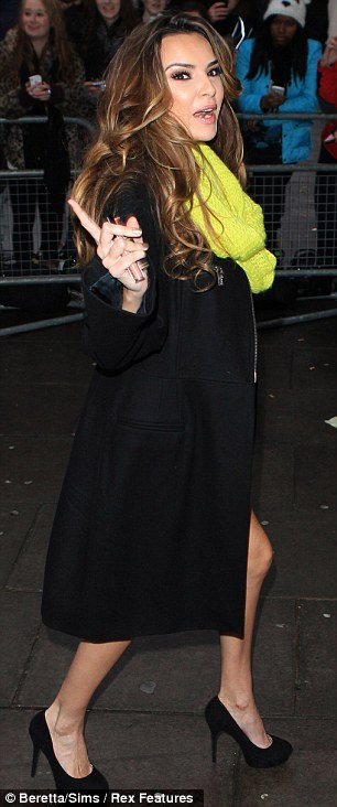 Work time: Her bandmate Nadine Coyle opted to instead bare her flesh in a mini polka dot dress and vibrant scarf