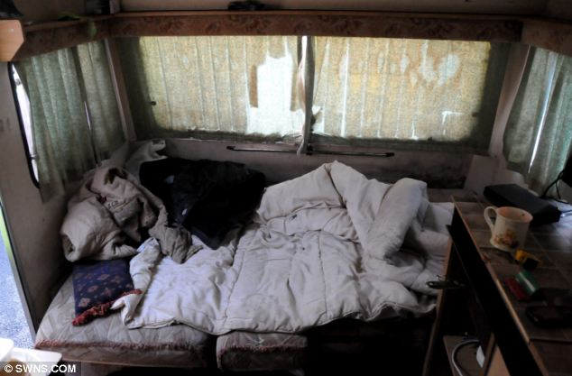 Cramped: Workers were made to live in caravans owned the Connors family, who had purchased several sites