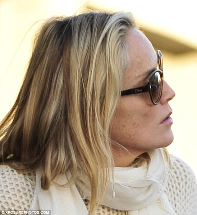 No blusher: Sharon Stone couldn't hide her liver spots on her face as she went Christmas shopping in Bel Air, California, on Thursday