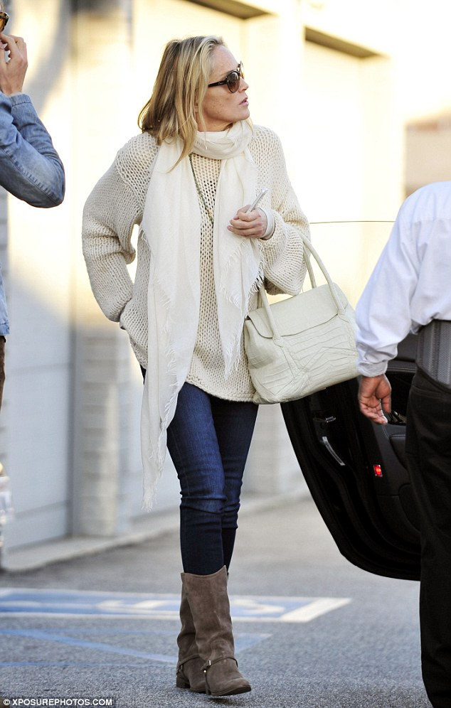 Basic Instinct: The actress looked good in her winter wardrobe of all white with blue jeans
