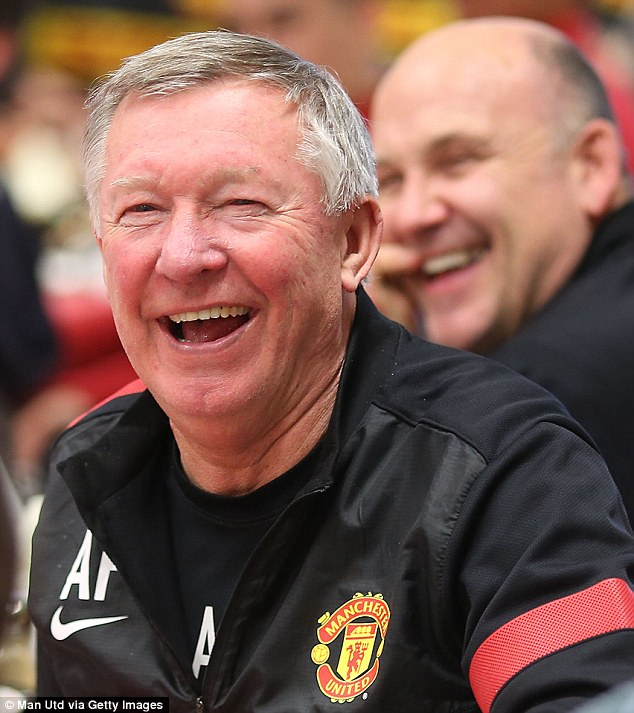 Tis the season! Sir Alex Ferguson is tickled by something in the club's annual Christmas panto, performed by youth team players