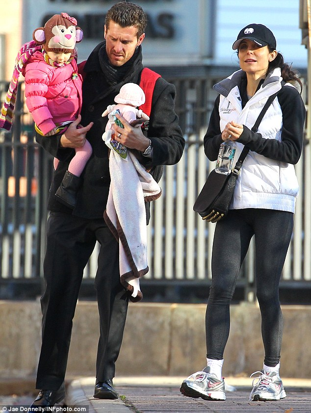 Happy front: Frankel was last photographed with businessman Jason Hoppy and their two-year-old daughter Bryn out on a drizzly stroll through the city Friday
