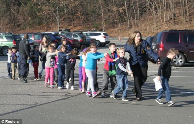 Horror: Crying children are led from the school where the gunman opened fire on Friday morning