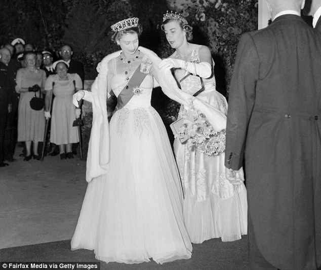 Lady Pamela adjusts Queen Elizabeth's stole at the Royal Ball in Melbourne, March 1954