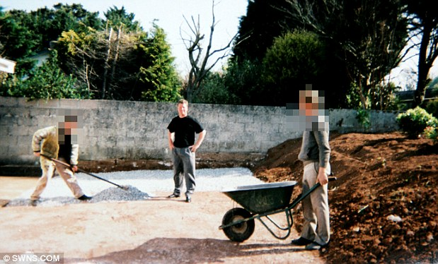 Exploitation: William Connors with his labourers at a construction site. One told reporters he felt unable to leave because he had no money and was an alcoholic