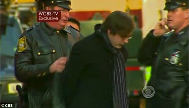 Led away: Ryan Lanza has not been named as a suspect but was taken away in handcuffs