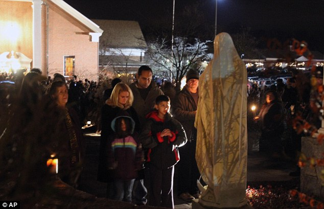 Prayers: Mourners prayed for the 20 children and six adults killed in Newtown, Connecticut, on Friday