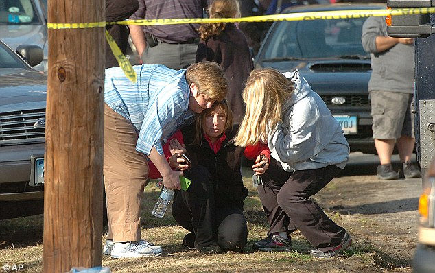 Tears: Parents sob outside Sandy Hook Elementary School, where 25 people were gunned down