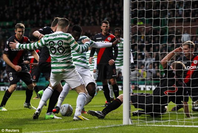Scramble: Celtic's Victor Wanyama (4th L) scores against St Mirren