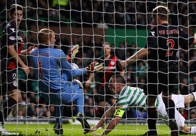 So close: Celtic's Scott Brown (2nd R) attempts a diving header