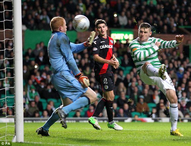 Cool finish: Celtic's Gary Hooper scores the opening goal