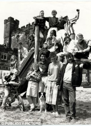 Benwell Towers, pictured behind the cast, pictured in 1990, lay empty since 2006 when the BBC pulled the plug on Byker Grove after 17 years. Jill Halfpenny can be seen on the far left