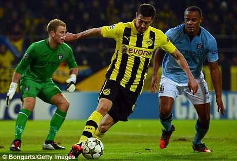 Manchester move? Robert Lewandowski, seen here playing for Borussia Dortmund against Manchester City in the Champions League, could be on his way to either City or United