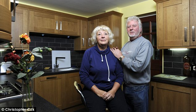 Devastated: Ann Reeve and Peter Gould in their kitchen, now refurbished