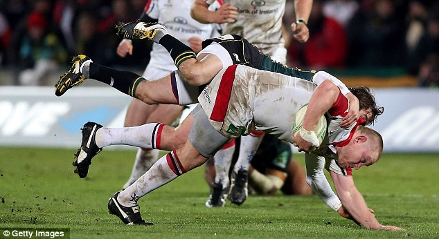 Tom Court of Ulster is tackled by Lee Dickson