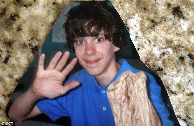 Baby-faced: Adam Lanza pictured during his secondary school days. His mother taught him how to shoot