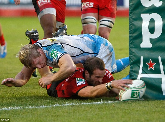 Blitz: Sale's David Seymour is powerless to stop Toulon scrum half Frederic Michalak touching down near the post in the French side's resounding 62-0 win