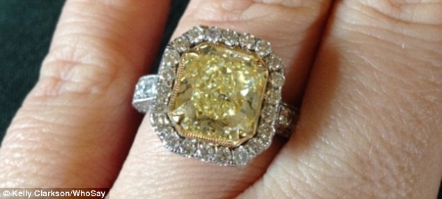 The ring revealed: Kelly Tweeted a picture of her 'canary yellow' diamond ring a few hours after her engagement