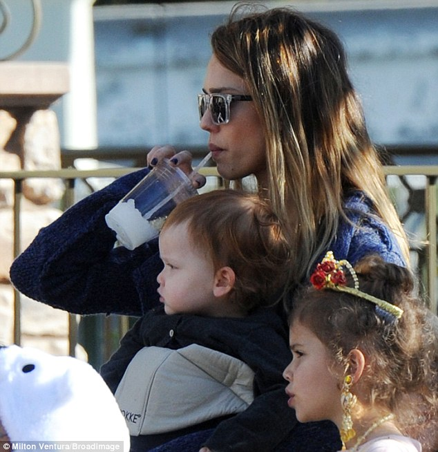 Keeping hydrated: The sensible Fantastic Four favourite made sure she kept herself well watered during the visit