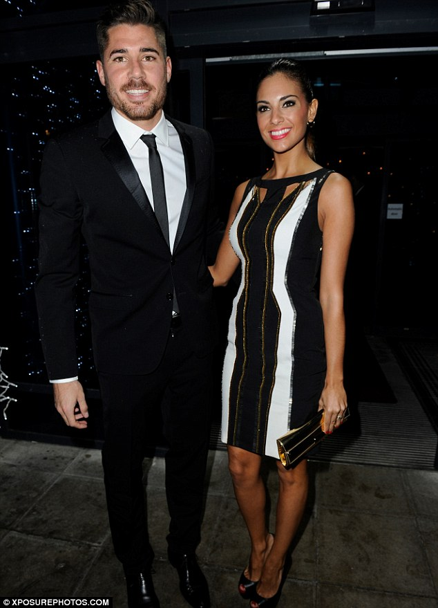 Stylish couple: Javier Garcia and Elena Gomez looked chic as they made their way inside