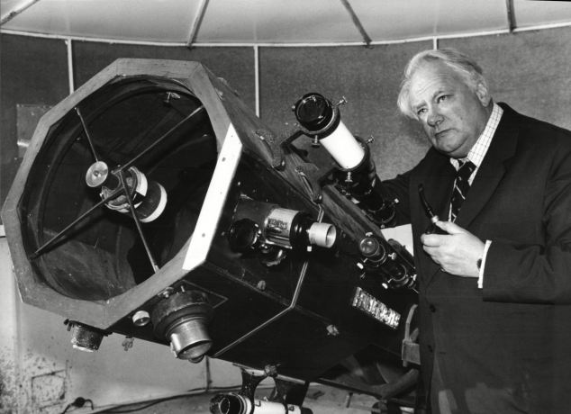 The sky at night: Sir Patrick with his 15ins telescope at his house in Farthings, Selsey, 30 years ago