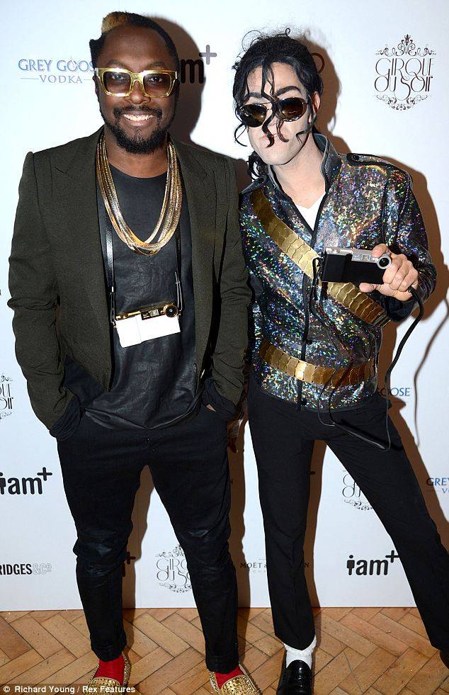 MJ: Will.i.am was joined by a Michael Jackson look-a-like at the event who posed with the gadget