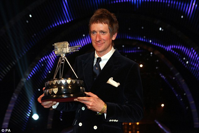Suits you: Winner of Sports Personality of the Year 2012, Bradley Wiggins  shows off the trophy