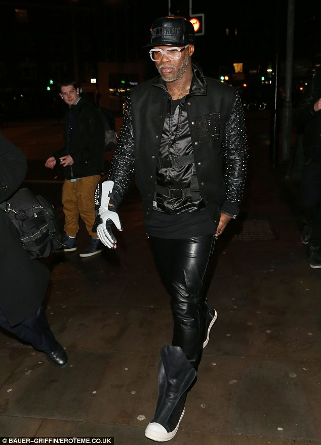 Matchy matchy: Footballer Djibril Cissé arrived wearing a similar black leather jacket to the one worn by his rumoured girlfriend Chloe Green