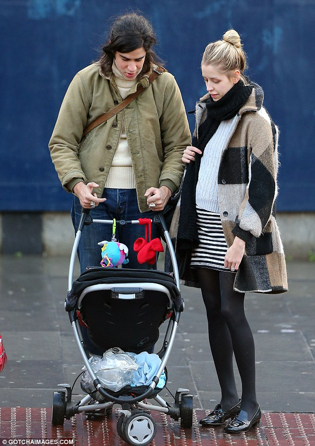 Expecting parents: Peaches Geldof was seen showing off her baby bump as she enjoyed a stroll with husband Tom Cohen and their eight-month-old son Astala on Sunday