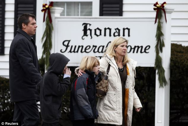 Grieving: Mourners arrive at the Honan Funeral Home