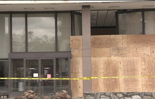 Boarded up: The couple took a car ride to look at the impact of Hurricane Sandy
