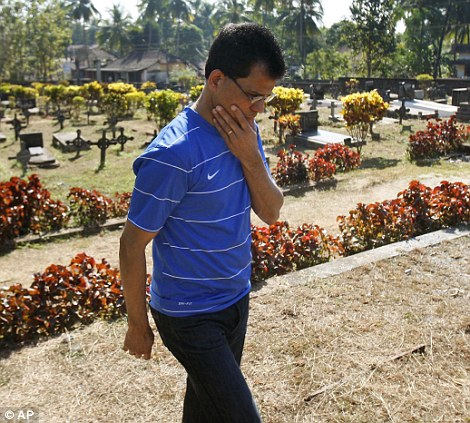 Distraught: Ben Barboza, husband of nurse Jacintha Saldanha, arrives today to examine the scene at the graveyard where his wife will be buried, in Shriva, north of  Mangalore, in India