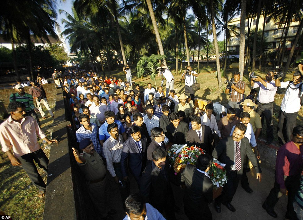 Procession: Relatives carry the coffin containing the body of Ms Saldanha for burial at her hometown Shirva