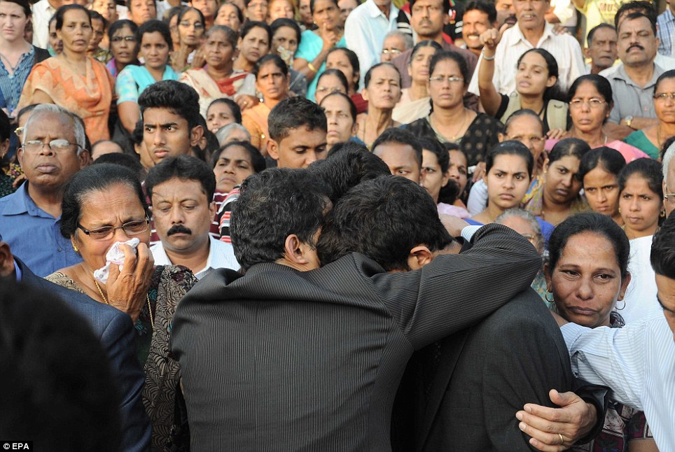 Watching on: Family members of Jacintha Saldanha weep as they attend her burial, following a memorial service attended by some 4,000 mourners