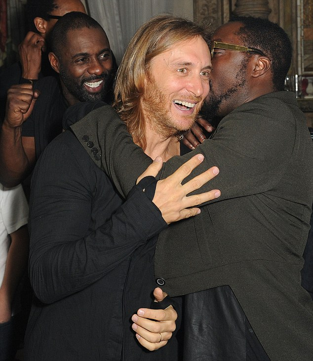 Hug it out: will.i.am gets a big hug from David Guetta who DJ'd at the event