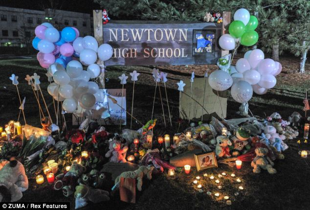 Tragic: Flowers and gifts left at the makeshift memorial outside the location of the interfaith vigil