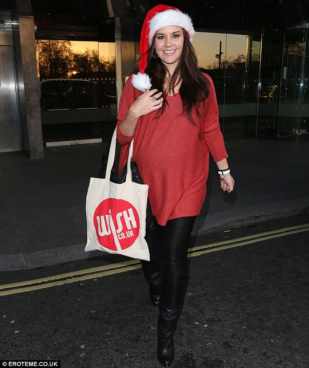Mrs Claus: Imogen Thomas seemed to have channelled Santa as she stepped out in a fun festive ensemble on Monday afternoon