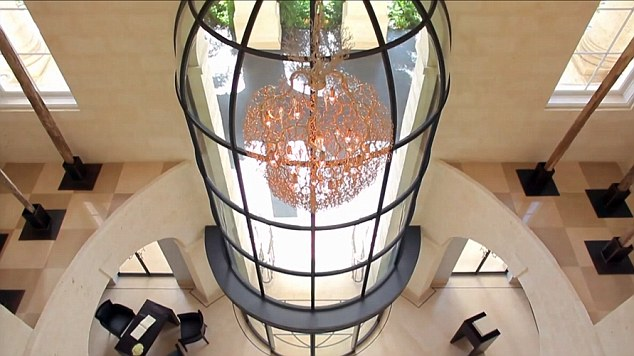 Chandelier: The spacious hallway at One Sandy Lane