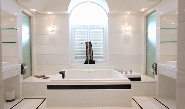 Bathe in style: A spacious, all-white bathroom at One Sandy Lane