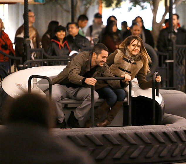 Big kids: Jessica Alba and a friend enjoy Luigi's Flying Tires at Disneyland's Cars Land on Saturday in Anaheim, California