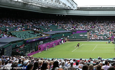 New balls: Ninety-seven per cent of seats during Djokovic's match were given to the Olympic family