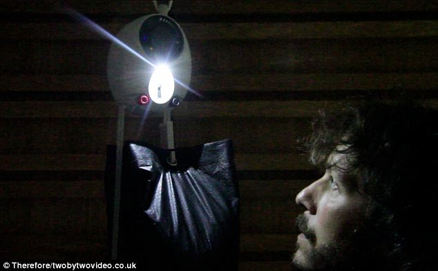 Elegant solution: The GravityLight in action. A sack containing sand or rocks gradually pulls a rope through the device's mechanism to gradually generate electricity
