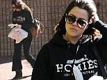 Riding high: Make-up free Khloe Kardashian wears her sweatpants at half mast as she runs errands around town